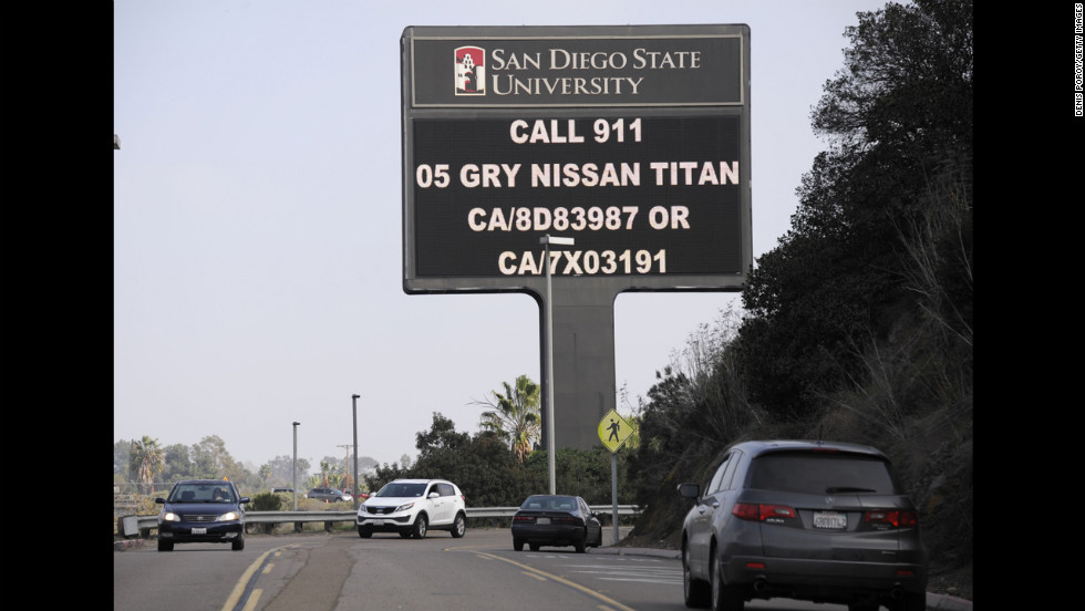 An illuminated sign at San Diego State University along Interstate 8 displays information about Dorner's last known vehicle on February 7.