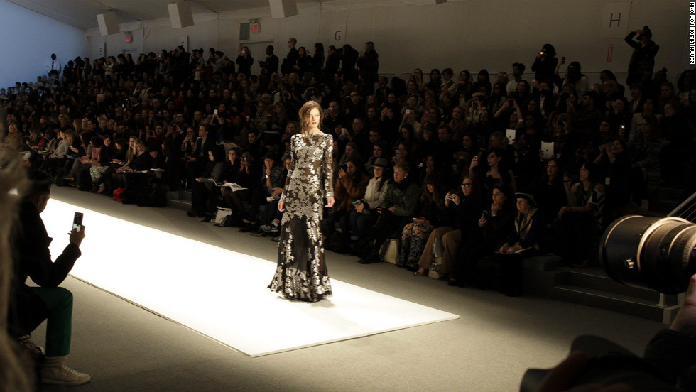 A model stops at the end of the runway on February 7. She's wearing a dress from Tadashi Shoji's latest collection.
