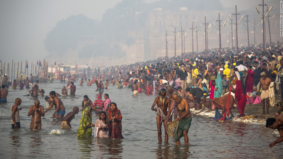 Hindu devotees bathe in the waters of Sangam on January 15.