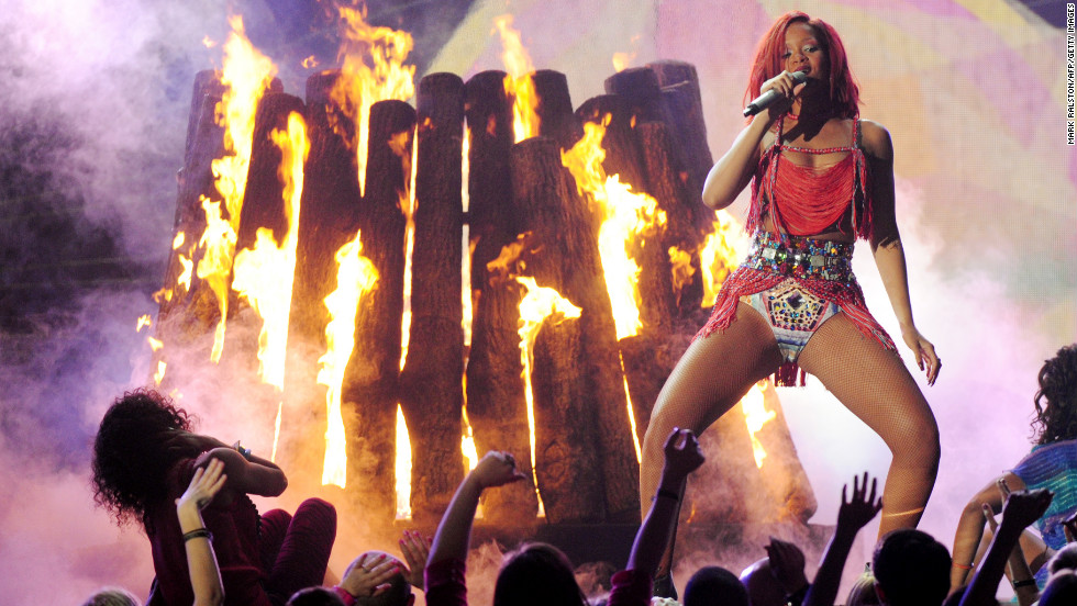 "Rihanna performs onstage during the 2011 Grammy Awards. In February, Schnegg <a href=""http://www.cnn.com/2011/SHOWBIZ/celebrity.news.gossip/02/22/chris.brown.hearing/index.html"">lifted the ""stay away"" order</a> imposed on Brown."