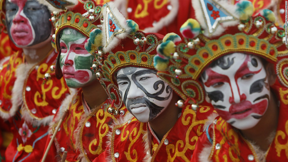Traditional Chinese dancers get ready before celebrations in Thailand's Suphan Buri province on February 8.