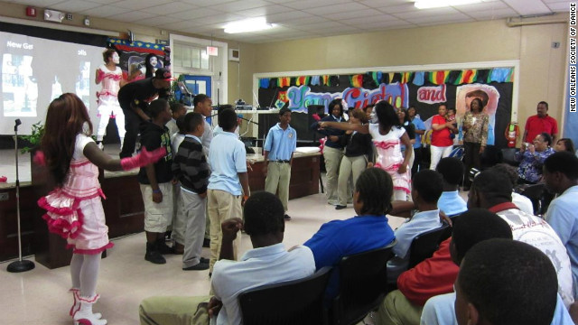 The Baby Doll Ladies with DJ Hektik dance with students at the McDonogh 42 Charter School in spring 2011.