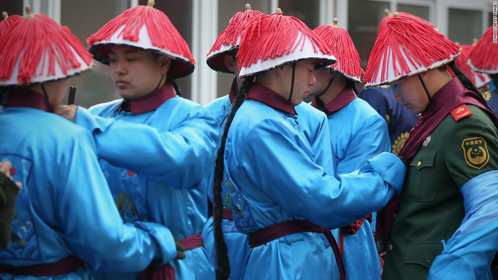 Chinese paramilitary police officers are dressed as Qing Dynasty servants before a re-enactment at Ditan Park, also known as Temple of Earth on February 9.