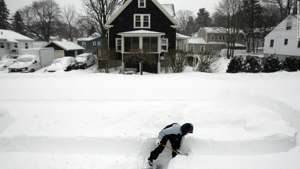 Mary Leahy shovels her sidewalk in Medford, Massachusetts.