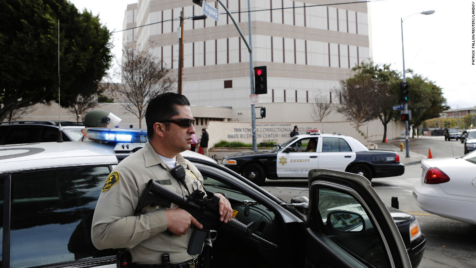 Officers keep watch outside of the Twin Towers Jail in response to an unconfirmed sighting of Dorner in Los Angeles.