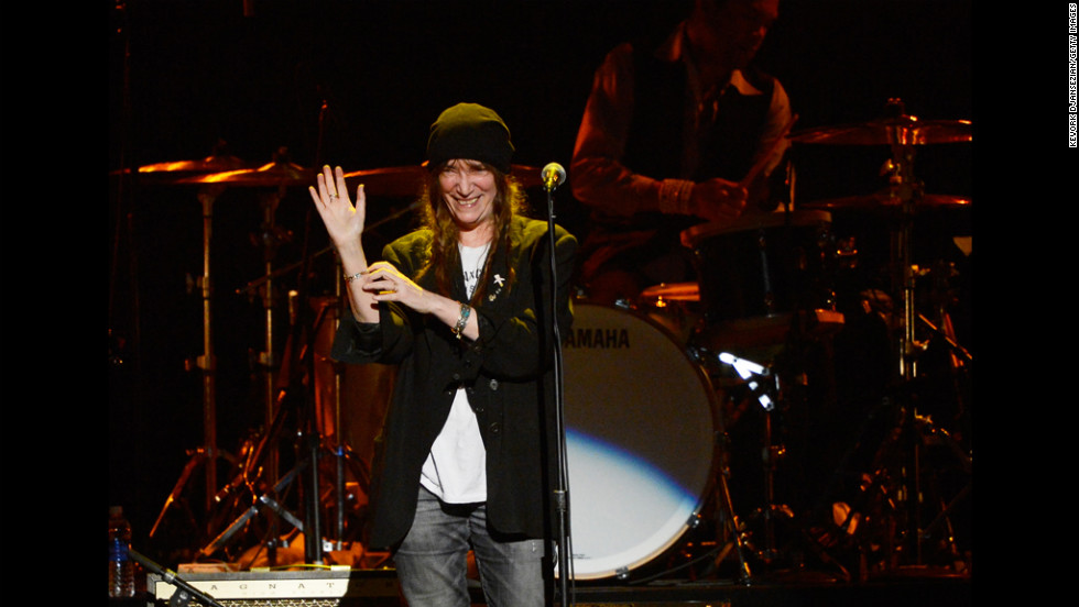 "Singer Patti Smith waves to the audience during her performance of ""Because the Night."""