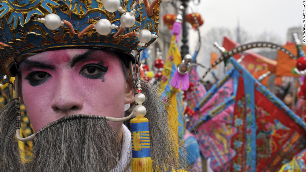 A traditionally dressed performer celebrates the new year in a parade in Paris on February 10.