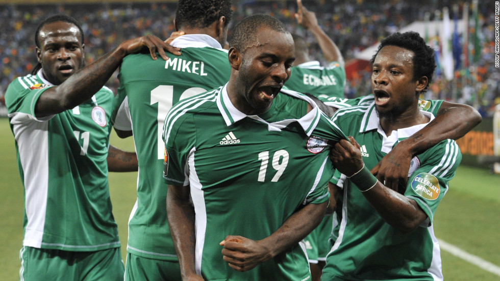 Sunday Mba (center) celebrates with his Nigeria teammates after scoring the only goal of the final against Burkina Faso.