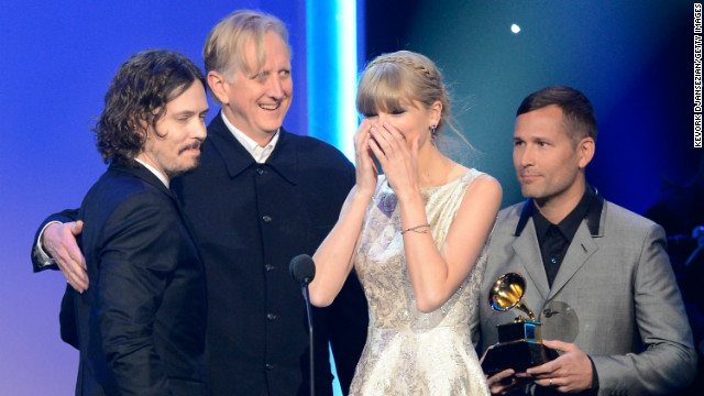 Taylor Swift accepts the Grammy award for best song written for visual media along with John Paul White and T Bone Burnett.