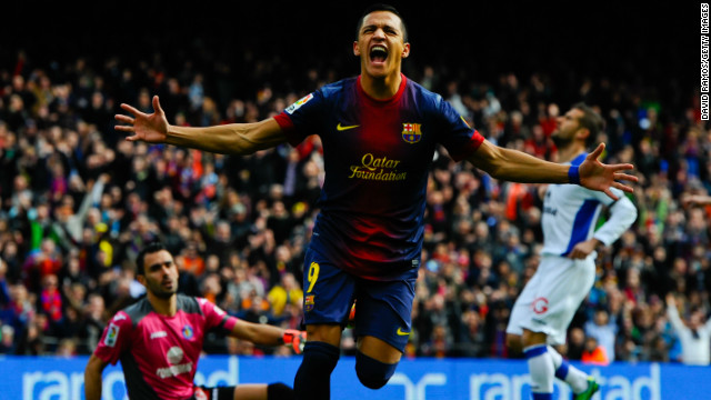 Alexis Sanchez celebrates after scoring Barcelona's opening goal against Getafe on Sunday.