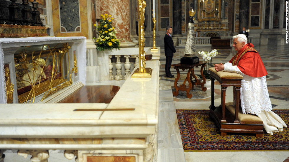 Benedict kneels as he prays in front of Pope John XXIII's tomb in St. Peter's Basilica at the Vatican on October 28, 2008, to commemorate the 50th anniversary of John's election to the papacy.