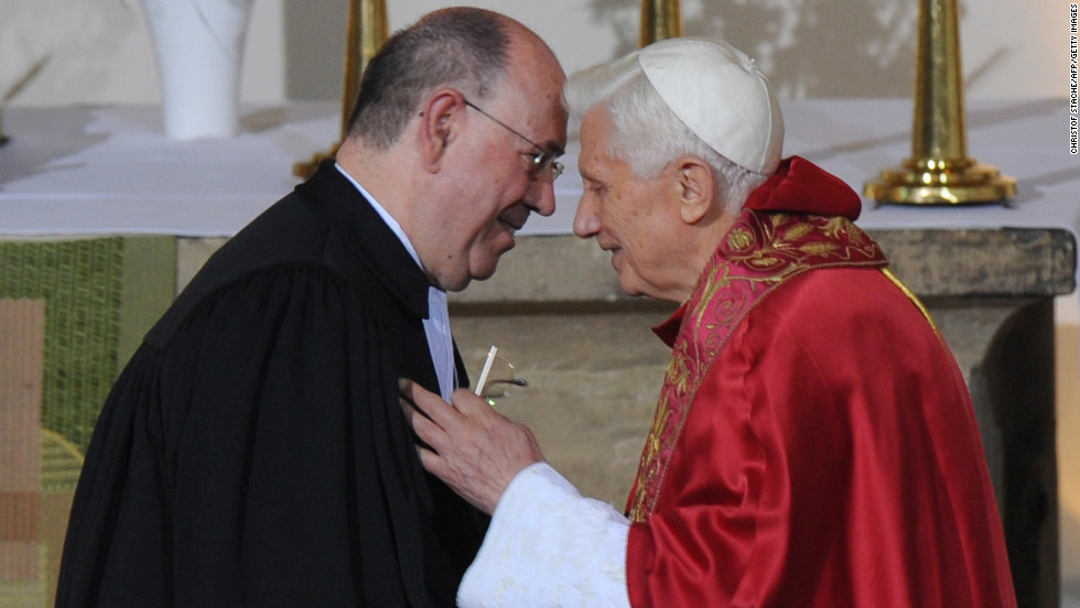 Benedict speaks with Nikolaus Schneider, praeses of the Evangelical Church in the Rhineland, before a Mass at the Augustinian monastery in Erfurt, Germany, in September 2011.
