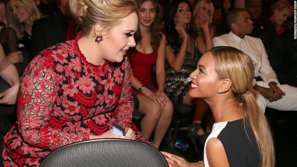 "Beyonce: ""Do you see that girl in the red trying to photobomb us right now?!""<br />Adele: ""Bey, I do! Just ignore her and smile."""