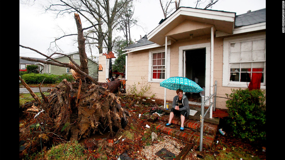 Ellen Chmiel surveys the damage from the steps of her Hattiesburg home on February 11.