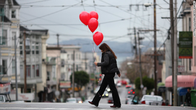 A woman carries a bunch of balloons as she walks down Union Street in San Francisco on Valentine's Day 2011.