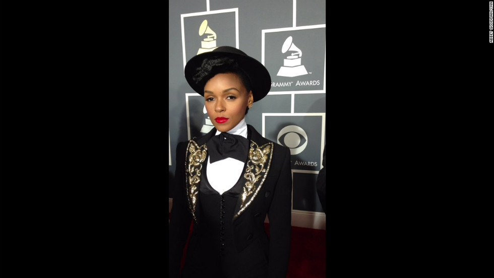 Just outside the frame is total chaos, but Janelle Monae remains perfectly poised - not to mention totally poreless. No Instagram filter was applied to this photo.