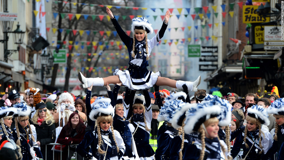 A performer is lifted into the air during the Rose Monday parade in Düsseldorf.