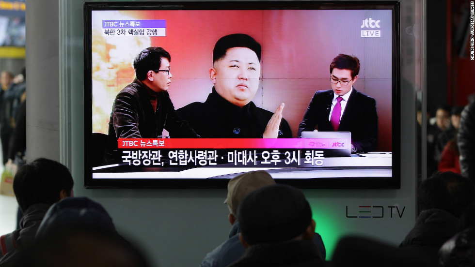 People watch a television broadcast reporting the North Korea's nuclear test at the Seoul Railway station on February 12, 2013 in Seoul, South Korea.