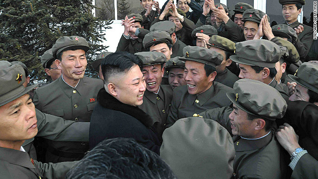 This picture taken by North Korea's official Korean Central News Agency (KCNA) on December 12, 2012 shows North Korean leader Kim Jong-Un (lower L) celebrating with staffs from the satellite control center during the launch of the Unha-3 rocket, carrying the satellite Kwangmyongsong-3, at the general satellite control and command center in Pyongyang.