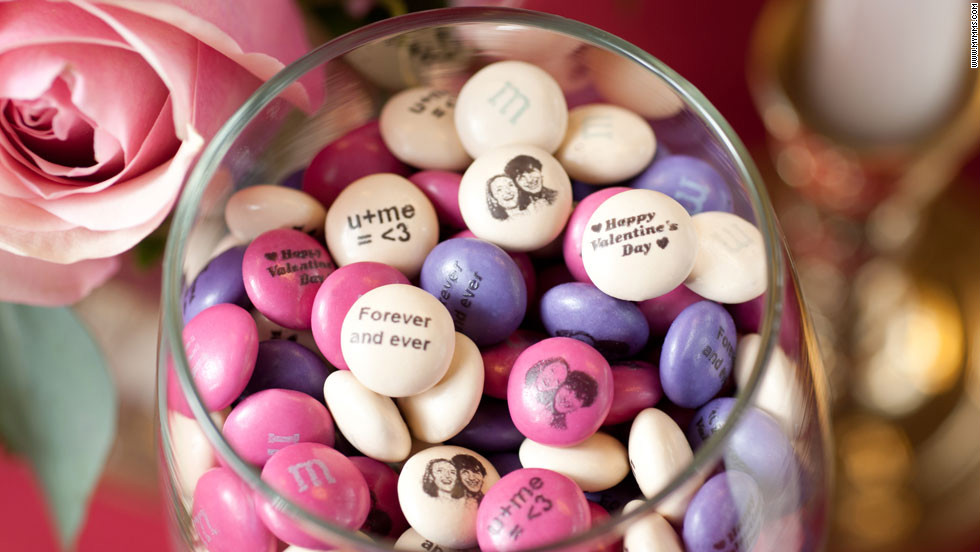 If you struggle to communicate your through chalky heart candy, try baring your soul with personalized M&Ms.