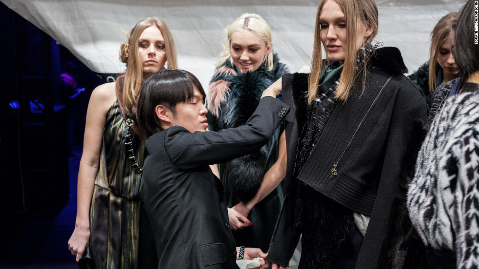 Designer Brandon Sun preps models backstage during his show. Sun launched his first collection of luxury fur accessories in 2011.