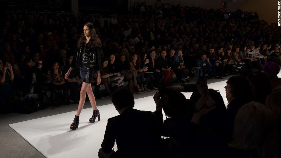 A model approaches the end of the runway during the Custo Barcelona show on February 10.