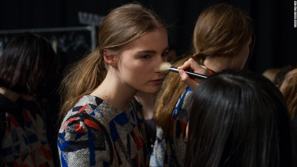 A model gets a touchup before hitting the runway on February 13.