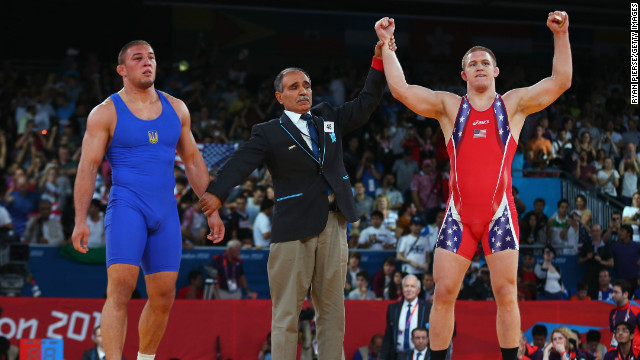 U.S. wrestler Jacob Stephen Varner, right, celebrates victory over Ukraine's Valerii Andriitsev at the 2012 London Games.