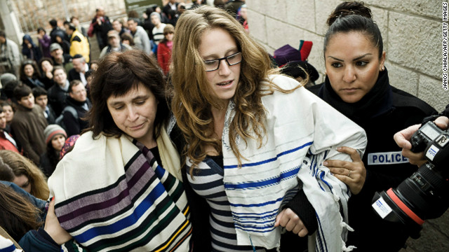 Israeli police arrest American Rabbi Susan Silverman (L) and her teenage daughter Hallel Abramowitz (C) on Monday.