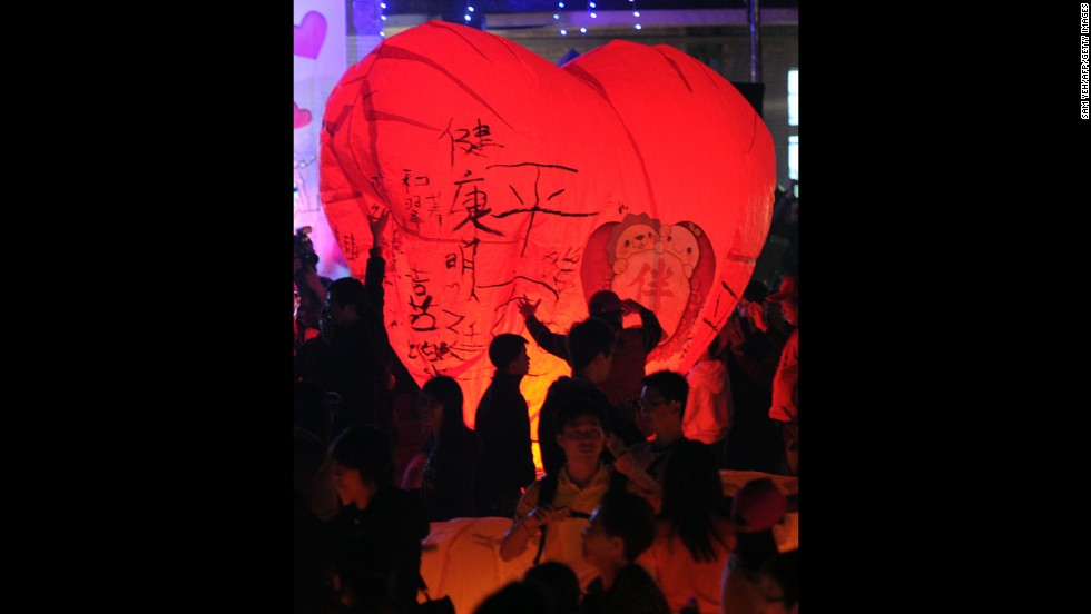 Residents of Taiwan release a heart-shaped sky lantern.