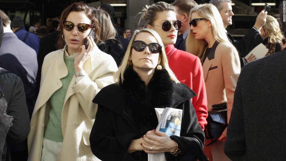People arrive for the Ralph Lauren show on February 14.