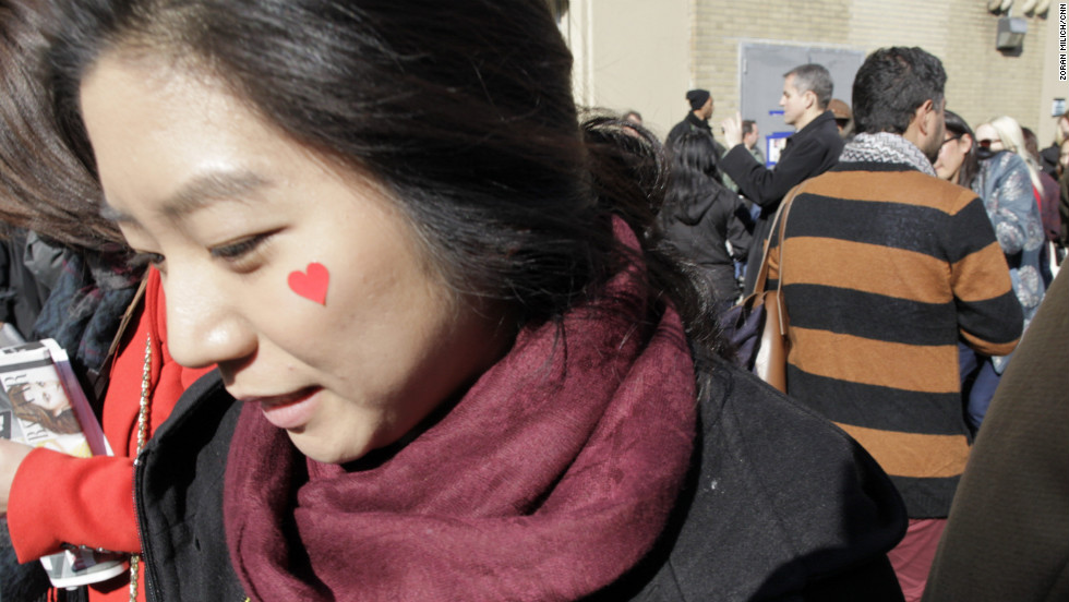 A woman shows her Valentine's Day spirit outside the Ralph Lauren show at Mercedes-Benz Fashion Week.