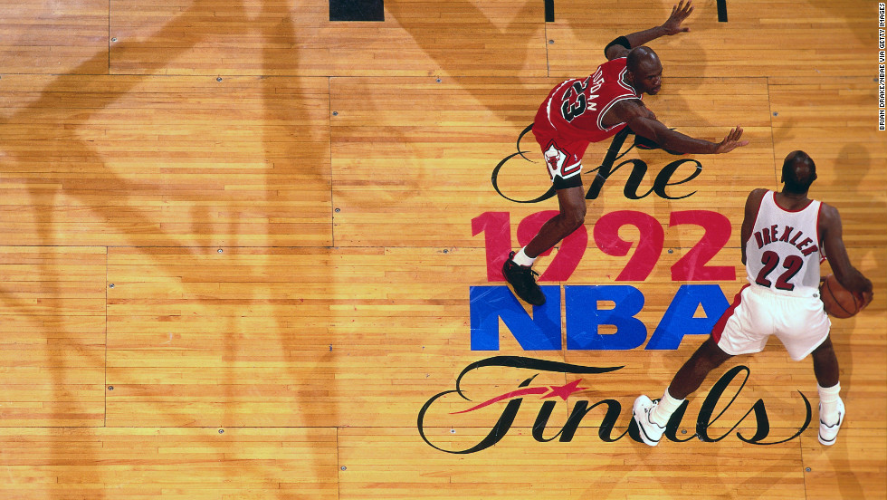 Clyde Drexler of the Portland Trailblazers drives against Jordan during the 1992 NBA Finals.