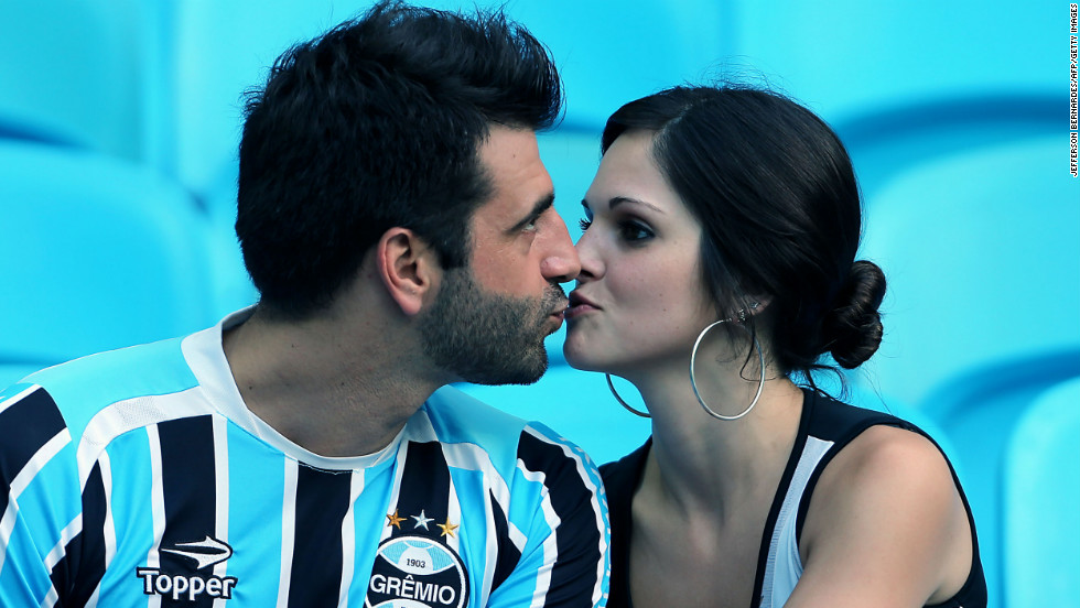 A couple kisses on Valentine's Day before the soccer match between Gremio of Brazil and Huachipato of Chile for the Libertadores Cup, in Porto Alegre, Brazil.