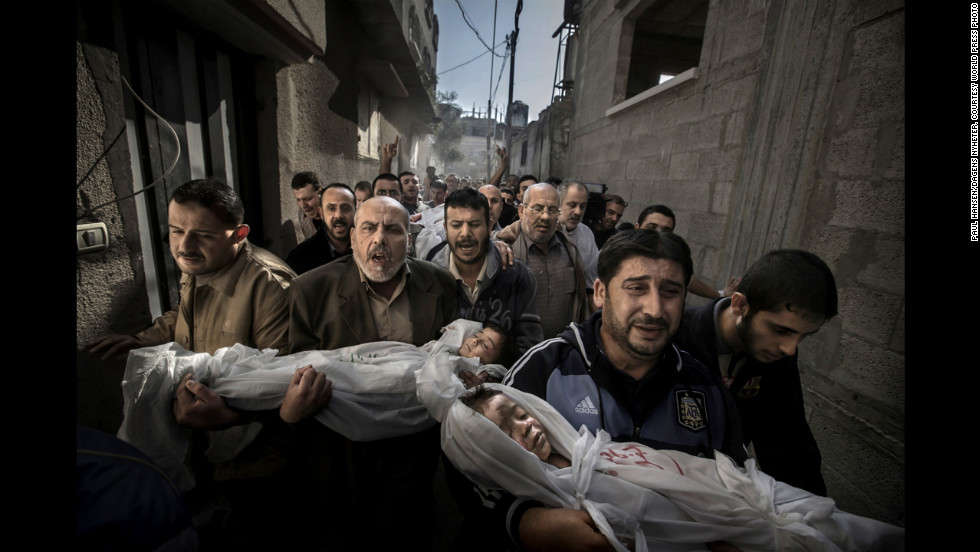 <strong>World Press Photo of the Year: </strong>Suhaib Hijazi, 2, and his brother, Muhammad, 3, were killed when an Israeli airstrike struck their Gaza City house, photographer Paul Hansen said. Their father, Fouad, was also killed, Hansen said. In the photo, Fouad's brothers carry the children's bodies to a mosque for burial on November 20, 2012, while the father's body follows behind on a stretcher. The following are a selection of the other World Press Photo winners: