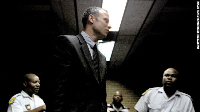 South Africa's Olympic sprinter Oscar Pistorius leaves the court room after his hearing on charge of murdering his model girlfriend Reeva Steenkamp on Valentine's Day, yesterday, on February 15, 2013 at the Magistrate Court in Pretoria.