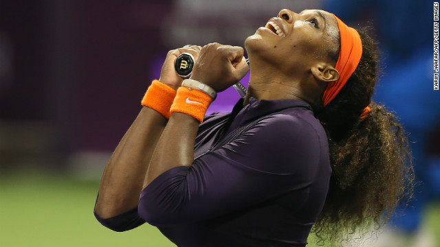 Serena Williams celebrates after claiming the victory which will send her back to the summit on Monday.