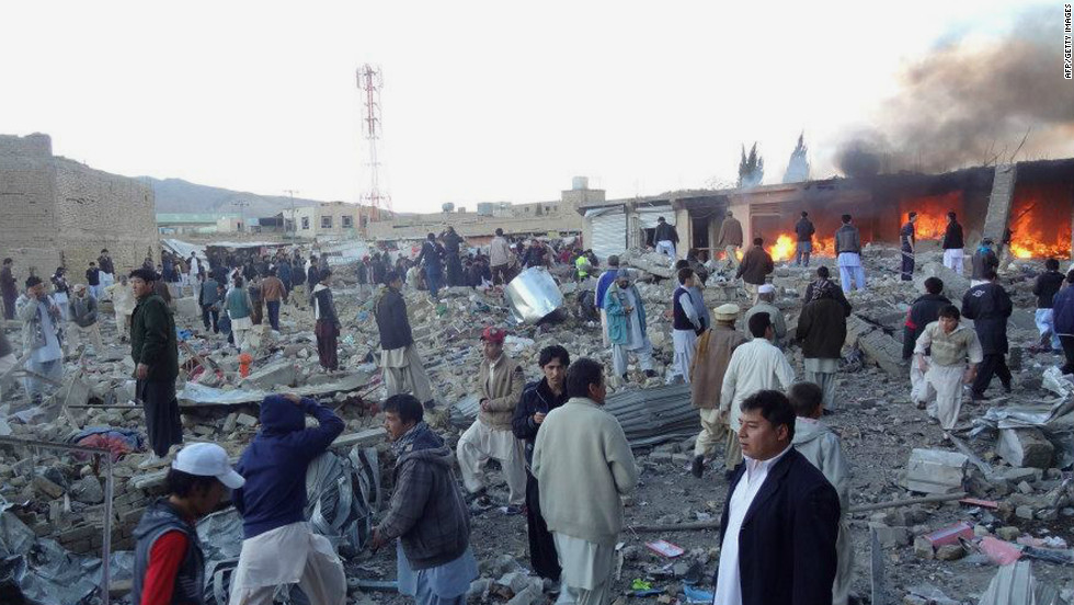 People gather after a bomb targeting Shiite Muslims exploded in a busy market in Hazara on the outskirts of Quetta, Pakistan, Saturday, February 16. A blast targeting Shiites in a busy marketplace killed at least 45 people, police told CNN.
