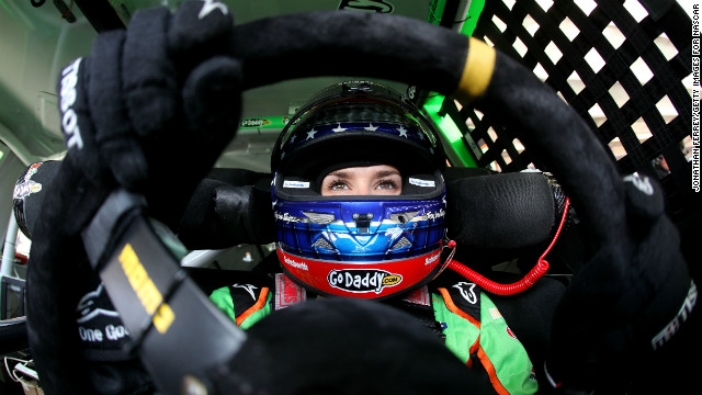 Danica Patrick, driver of the #10 GoDaddy.com Chevrolet, sits in her car during practice for the NASCAR Sprint Cup Series AdvoCare 500 at Phoenix International Raceway in 2012 in Avondale, Arizona.