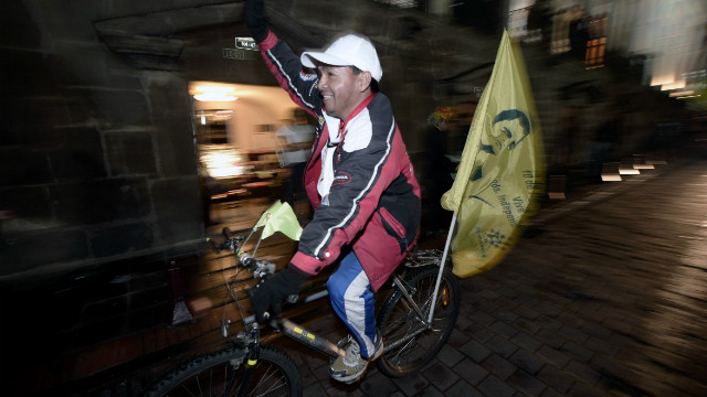 A supporter of Ecuadorian President Rafael Correa celebrates Correa's apparent re-election Sunday.