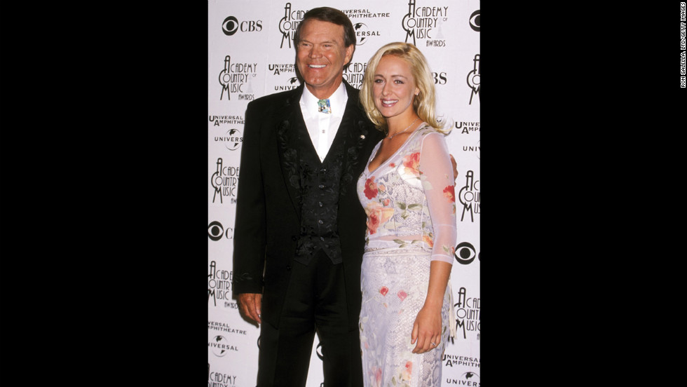 McCready attends the 33rd Annual Academy of Country Music Awards with musician Glen Campbell in April 1998 in Universal City, California.