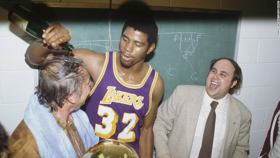 "The Lakers won their first of 10 championships under Buss. Veteran center Kareem Abdul-Jabbar averaged a monstrous 32 points, 13 rebounds and four blocks during the playoffs, but he had to share the stage with a 20-year-old rookie who would soon become a legend himself, Earvin ""Magic"" Johnson. Pictured, Johnson dumps champagne on Buss after winning a game in the 1980 series."