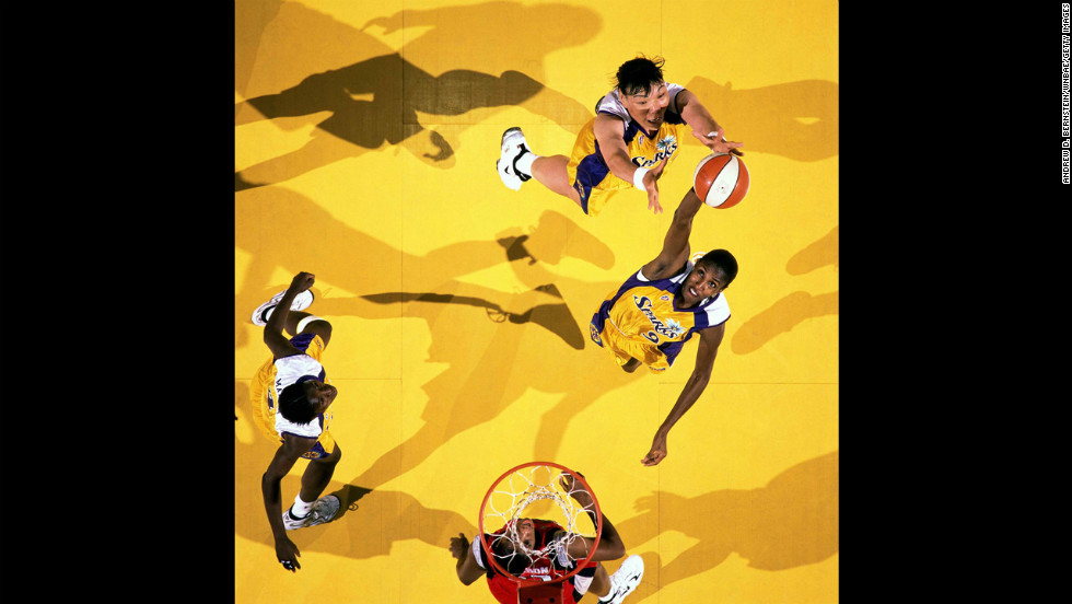 After the WNBA is formed, Buss operated the Los Angeles Sparks franchise. Lisa Leslie joined the inaugural team in 1997, proving Buss' reputation for snaring supreme talent knew no gender boundary. Leslie's storied career included seven All-Star appearances, four Olympic gold medals and two WNBA titles. Pictured, Leslie grabs a rebound during a 1997 WNBA game against the Houston Comets.
