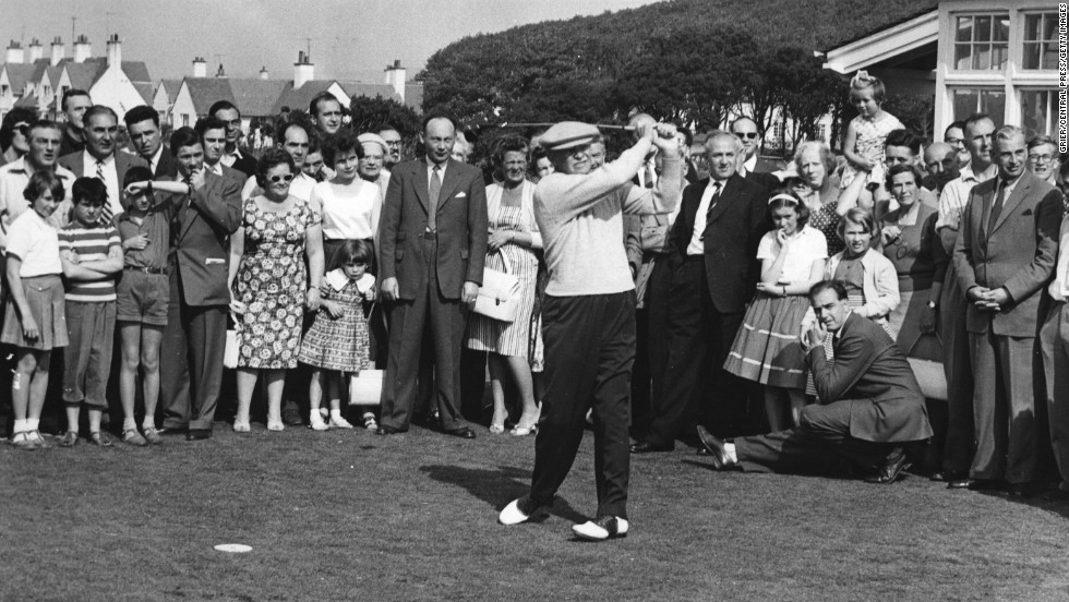 President Dwight D. Eisenhower drives down the fairway at Turnberry golf course during a weekend stay at Culzean Castle on the Ayrshire coast of Scotland on September 5, 1959. Eisenhower often carried a club in the Oval Office and took swings while dictating to his secretary.