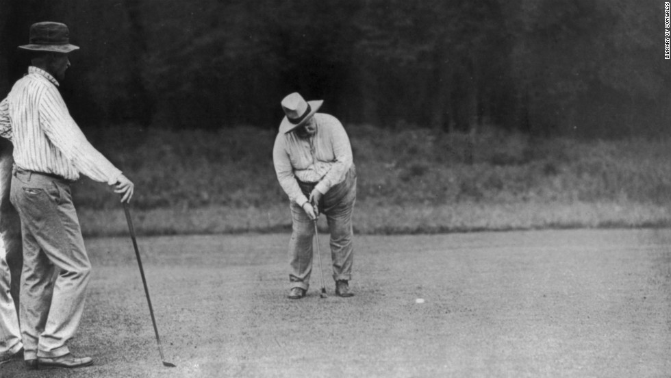 President William Taft, the 27th U.S. president, putts on the green in Chevy Chase, Maryland, on June 28, 1909. He is said to be the first presidential golfer.