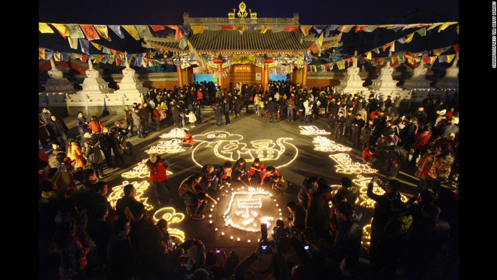 People light candles at Guangren Temple in Xi'an, China, on February 17.