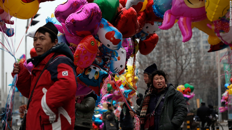 People sell balloons at a Spring Festival Temple Fair celebrating the new year on February 11 in Beijing.