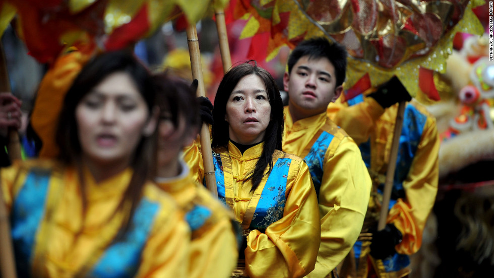 Traditional Chinese dancers take part in the New Year parade on Sunday, February 10, in London.