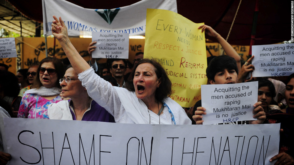 Pakistani human rights activists hold placards in the support of Mai during a demonstration in Karachi on April 23, 2011. Human Rights Watch called on Pakistan's government to seek a review of the acquittal of five men accused of her gang rape nearly a decade earlier.