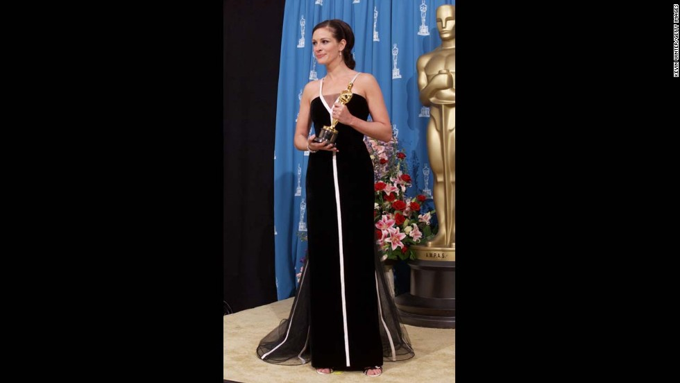 "In 2001, Julia Roberts accepted her Oscar for ""Erin Brockovich"" wearing a black and white vintage Valentino gown."